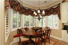 Enjoy your breakfast or brunch in this wonderful room with built-in window seats with views of the covered patio, summer kitchen, and pool through bay windows.