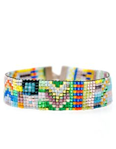 "The ""Victoria"" palette boasts vibrant brights alongside soft pastels and dazzling jewel tones, reminiscent of a summer garden. This everyday bracelet from Julie Rofman is a colorful staple. $110 #beads #jewlery"