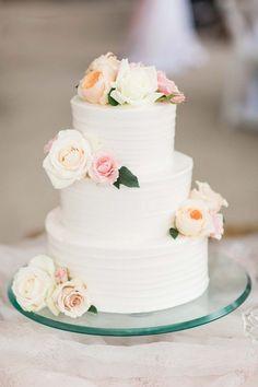 Classic wedding cake idea - white, three-tier wedding cake with fresh flowers {Erin Wilson Photography}