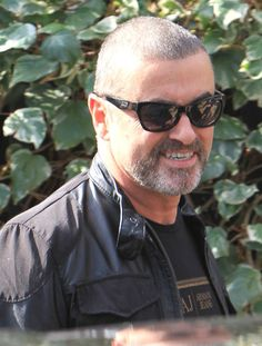 "George Michael Photos Photos - ""Faith"" singer George Michael and his boyfriend Fadi Fawaz are spotted out on March 21, 2012 in London, UK. - George Michael & Fadi Fawaz Out In London"