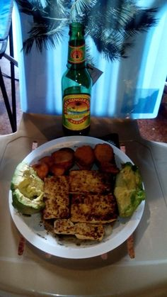 Curry basil tamarind Tofu lightly fried in grapeseed oil with oven roasted coconut sweet potatoes and fresh avocado. Summertime food and drink ginger beer. Under me Mighty Palm Tree