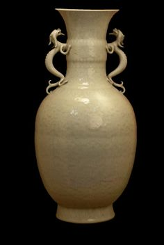A celadon vase with 2 dragon handles. Qianlong Mark, 19th - 20th century. H 24in. (60.9cm)