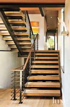 Contemporary Neutral Staircase with Walnut Treads