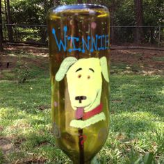 Recycled Yard Art.  Removed labels from wine bottles and painted our dogs and whimsical characters around the bottle, placed it upside down on a rebar.