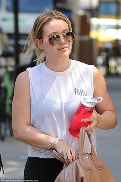 She's so fancy:The 28-year-old accessorized with a beige Givenchy purse, gold-rimmed Ray-...