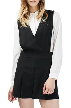 Achieve prep-school-chic style in this pinafore romper designed with playfully pleated shorts and an attached tailored shirt complete with dainty spread collar and sleek hidden placket.