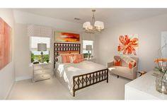 Guest bedroom with orange decor; The Parkhill floor plan, Drees Custom Homes, Austin