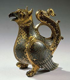Griffin Ewer (Aquamanile)  Circle of Roger of Helmarshausen  Lower Saxony, 1st quarter of 12th century  Gilt bronze, partially silver-encrusted, with niello;  H 17.3 cm, W 8.5 cm, L 14.5 cm  KK Inv. No. 83