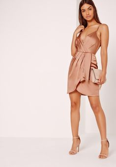 Shiny satin sh*t is guaranteed to make any outfit cool af and this dress has luxe vibes written all over it. In a champagne nude hue, adjustable cami straps, wrap style and a concealed back zip, we're teaming with barely there heels and a b...