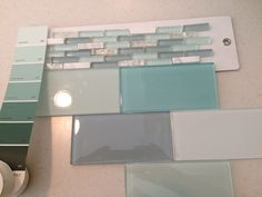 Kitchen or bathroom glass tile Backsplash. Glass tile seems more bathroomy to me. It's too modern for my taste in my kitchen, but I love it so much!