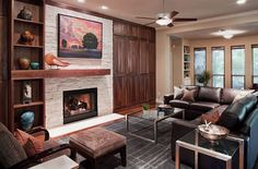 Love the asymmetrical mantle on the beautiful fireplace.