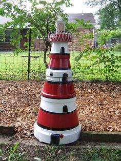 A lighthouse made out of pots !! Fab idea