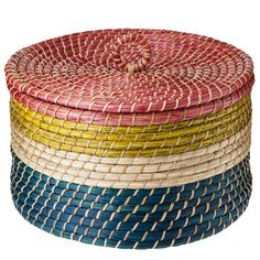 Our 13 Picks From the Nate Berkus Target Spring Collection: This pineapple finial ($25) doubles as a pretty decorative piece and a secret stashing place.   : We love the tropical stripes on this woven basket ($40).