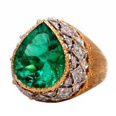Buccellati AGL-Cert Fine Colombian Emerald Diamond Gold Ring,This stunning designer Buccellati ring is finely crafted in solid 18K yellow gold. It displays a magnificent genuine AGL graded pear shaped rare Colombian emerald approx. 6.00 ct. is accented with 60 genuine round cut diamonds approx. 1.25ct, Fcolor, VVS clarity. This gorgeous Buccellati ring has fine detailed engraving and a brushed detail work.