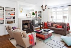 It's a common living room arranging dilemma: should your seating face the fireplace or TV? We show you a layout that works for both./