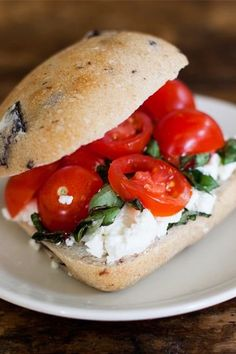 Goat cheese, tomato, and fresh basil on a fluffy olive roll