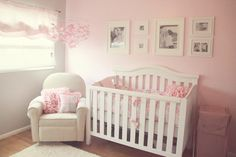 love the soft pink, white furniture, white frames, the mobile, and ruffled pillows