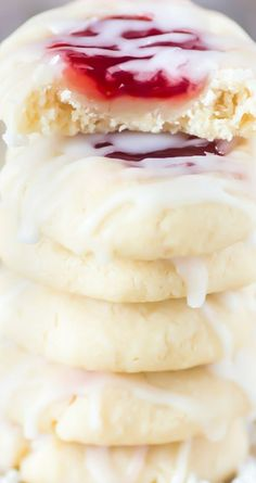 Glazed Strawberry Thumbprint Cookies ~ Buttery vanilla and almond flavored shortbread cookies with strawberry jam and drizzled with icing... These cookies will melt in your mouth.