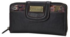 This Anna Nova Australia wallet features a wide opening allowing the wallet to open flat and has a huge 38 card spaces with a coin zip section on the back. Approx. 9in x 5.5in See something you like, I ship!
