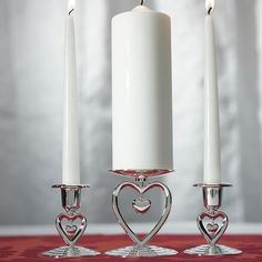 With suspended heart details, this romantic silver plated candle holder is perfect for your unity candle ceremony and are destined to become a cherished keepsake in the years that follow. Pair with ma