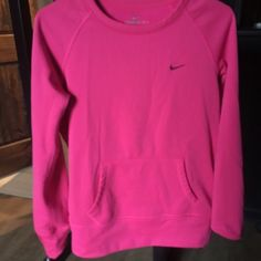 Pink Nike sweatshirt Pink Nike sweatshirt that has never been worn. Very soft and longer in length. Size small Nike Tops Sweatshirts & Hoodies