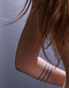simple blue arm band tattoo.