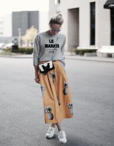 21 Genius Outfit Ideas to Steal This Summer: A ShoppableGuide | 'Happily Grey' blogger in Parisian slogan sweater paired with orange printed culottes and white sneakers