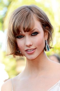 Cannes Film Festival 2013: Heavily-lined smoky eyes were the focus of Karlie Kloss' make-up at the premiere of The Immigrant, while her signature bob was styled naturally tousled.