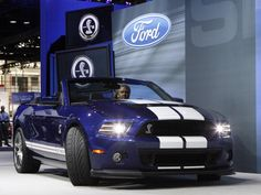 A 2012 Ford Shelby GT500 convertible is driven on stage during the first media preview day at the 2012 Chicago Auto Show in Chicago, Illinois February 8, 2012. REUTERS/Frank Polich
