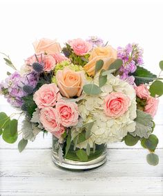 Deliver your sentiments with this hand-designed bouquet of floral favorites including flowering white hydrangea, pastel garden roses, lavender scented stock and garden blue thistle nestled in silver eucalyptus and presented in one of our chic glass. Pastel Bouquet, Pastel Flowers, Spring Flowers, Beautiful Flowers, Big Flowers, Simply Beautiful, Beautiful Flower Arrangements, Floral Arrangements, Funeral Flowers