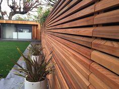 Cedar Slatted Fence in Modern Garden