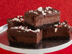 Day 9 of #12DaysOfCookies comes straight from our Pinterest fans! We asked for your favorite Holiday cookie and these Chocolate Cheesecake Candy Cane Bars won by a landslide.