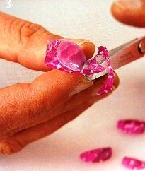 Decopatch decorated fingernails.