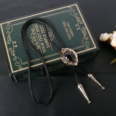 Find More Ties & Handkerchiefs Information about Fashion Brand Black Oval Rhinestone Bolo Ties for Men High end Shoestring Necktie Golden Jewelry Bolo Necklace Women Neckwear,High Quality tie up wedge sandals,China jewelry fashion and accessories show Suppliers, Cheap jewelry cabinet with mirror from Dotes Mall on Aliexpress.com