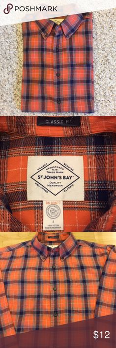Men's Flannel Buttondown Nice woven plaid flannel in orange and navy with a tiny amount of sage green and white. Soft 100% cotton, very cozy. My son only wore it a few times before outgrowing it. Great condition. St. John's Bay Shirts Casual Button Down Shirts