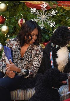 First Lady Michelle Obama toured the facility, visited with patients and families, read 'Twas the Night Before Christmas' to children!! Bo & Sunny #Obama #ChildrenNationalHealthSystem #WashingtonDC December 2015