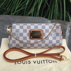 Louis Vuitton Damier Azur Eva *W/DUST BAG & STRAP* For sale: preowned authentic Louis Vuitton Eva in Azur Print. This purchase includes a dust bag, chain strap & cross body strap. Inside has some noticeable stains/marks, free of rips & tears, no odors. Outside: the canvass & golden brass plate has some scratches. Leather trims has oxidized nicely W/marks & scratches (no exposing or cracks). Leather strap has darken with many marks & shows heavy wears. Zipper works great, no issues. Hardware…