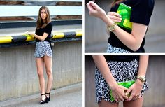 Shop this look for $1,486:  http://lookastic.com/women/looks/crew-neck-t-shirt-and-clutch-and-shorts-and-heeled-sandals-and-watch/3300  — Black Crew-neck T-shirt  — Green-Yellow Clutch  — White and Black Leopard Shorts  — Black Suede Heeled Sandals  — Gold Watch