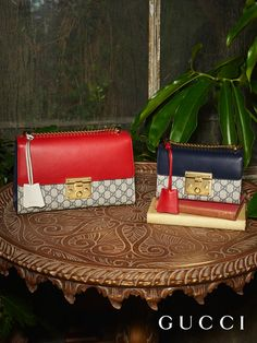 A pair of Gucci Padlock shoulder bags from Gucci Pre-Fall 2016, crafted in a mix GG motif and leather, with a key lock closure and sliding chain strap.
