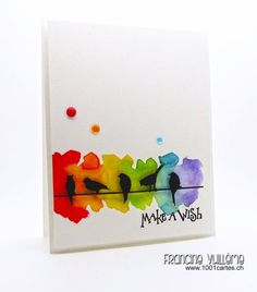 """I used watercolors to create the rainbow background. The """"Make a wish"""" sentiment & the """"In a row"""" die are both from Penny Black. To finish off my card, I added some sequins and enamel dots."""