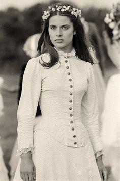 Nastassja Kinski in the movie, Tess; not the wedding gown, but dancing club dress..it evokes purity and innocence....