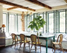 country cottage.  exposed beams, banquette, steel windows, and french bistro chairs   keith mcnally