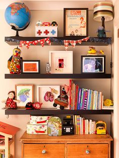 Books, Cars, Toys and Globes fight for space on the bookshelf by Jennifer Robertson, via Flickr