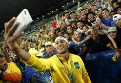 Neymar poses for a now obligatory selfie with fans.
