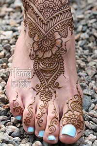 Foot mehndi design with turquoise nail polish on pebbles - Henna by Heather