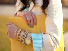 bracelets and yellow clutch.  ooh la la