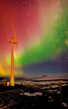 An aurora behind the wind turbine at Mawson Station (Australian Antarctic Division)