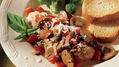 While the chicken breasts cook, whip together a garlicky mushroom-tomato topping fragrant with basil.