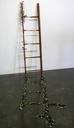 Helen Earl, Out of the Woods, 2010. Found carved ladder and ceramic leaves