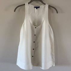 100% Silk Racerback Tank Ivory-colored tonal print. Button front with extra button included. Perfect condition - never worn. Martin + Osa Tops Tank Tops